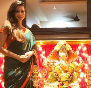 Shivani Surve with the idol of Lord Ganesha