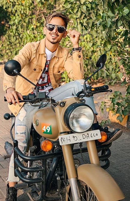Adnaan Shaikh with his bike