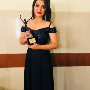Nidhi Jha with her Award