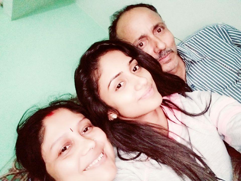 Nisha Guragain with her parents