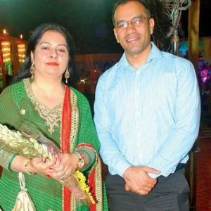 Puja Thakur Sekera with her husband