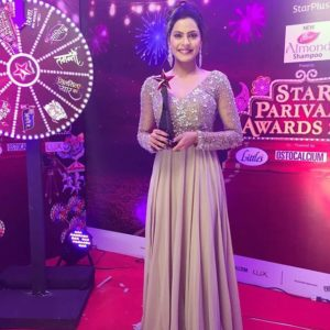 Anuja Sathe with her award