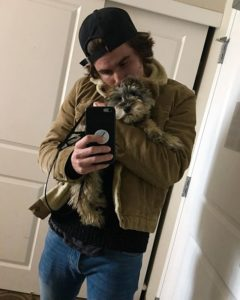 Chase Stokes with his pet dog