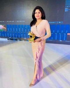 Kumkum Binwal with her award