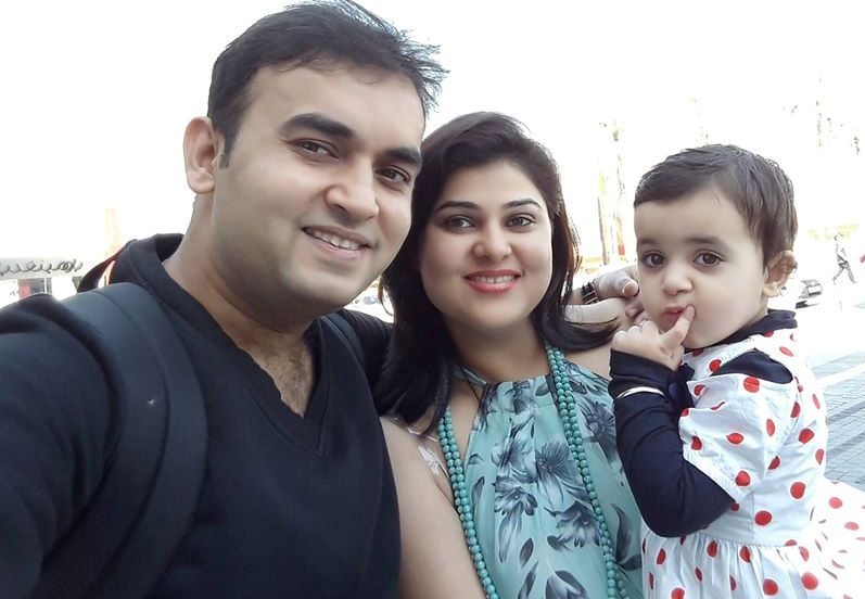 Nidhi Vasandani with her husband and daughter