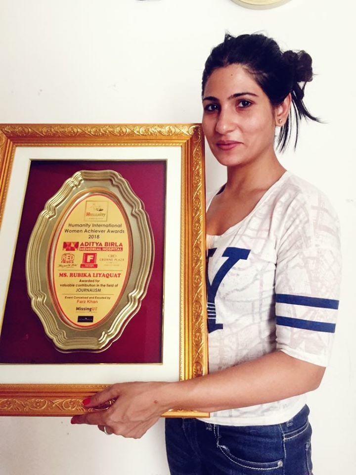 Rubika Liyaquat with her Award