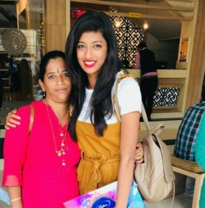 Mebiena Micheal with her mother