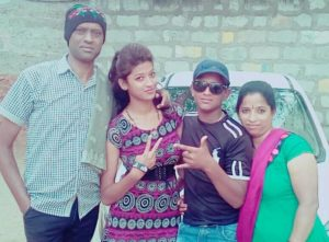 Mebiena Micheal with her parents and brother