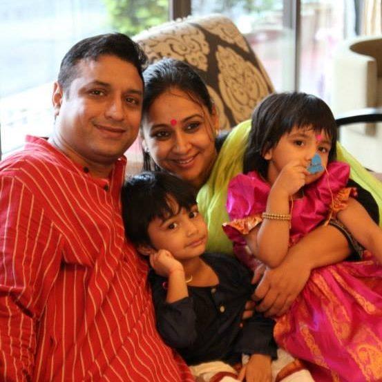 Priya Balan with her husband and children