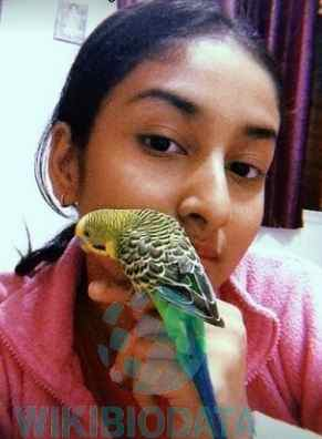 Anchal Sahu with her pet bird