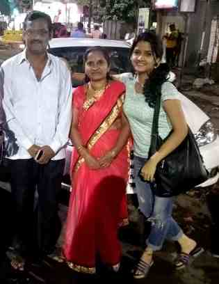 Mayuri Kapadane with her parents