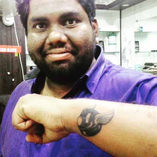 Harsha Chemudu a riding tattoo
