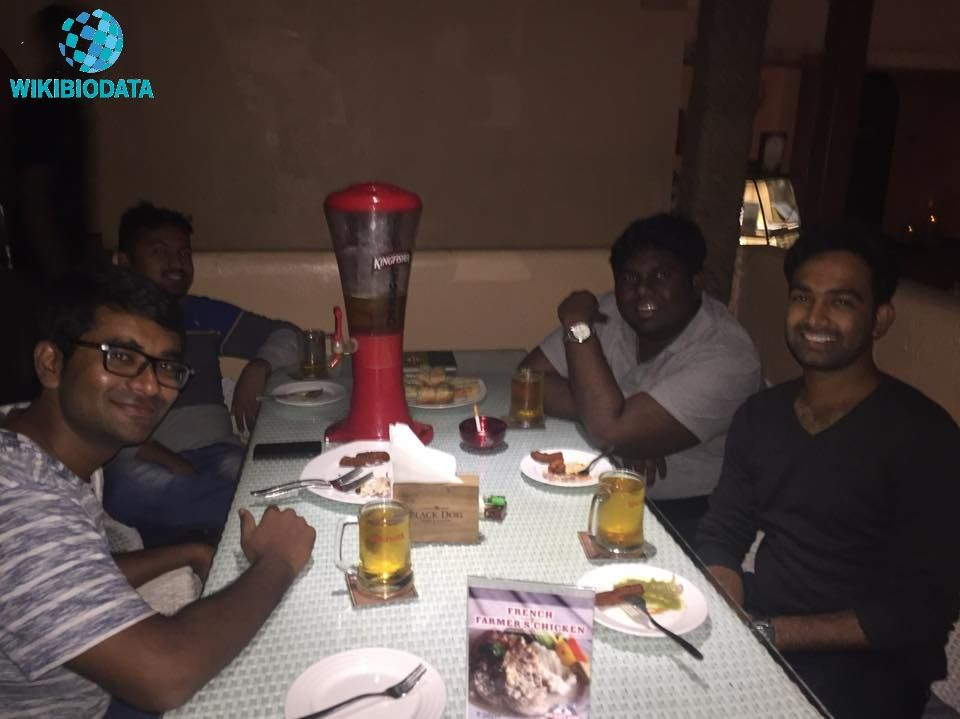 Harsha Chemudu with glass of alcohol