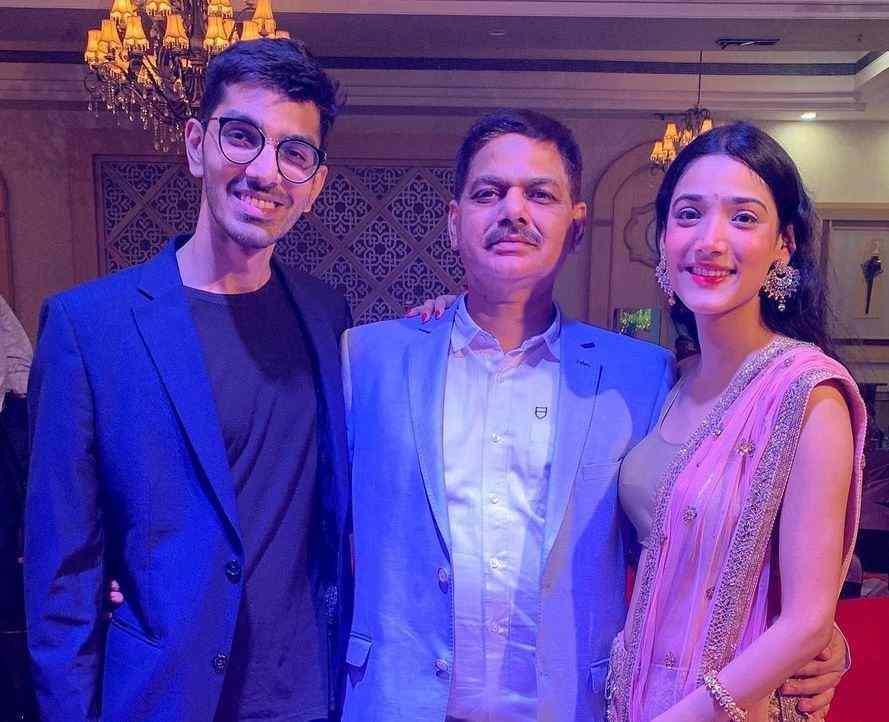 Medha Shankar with her father and brother